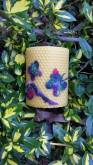 All-natural, hand-rolled beeswax pillar candle with rainbow beeswax butterflies.